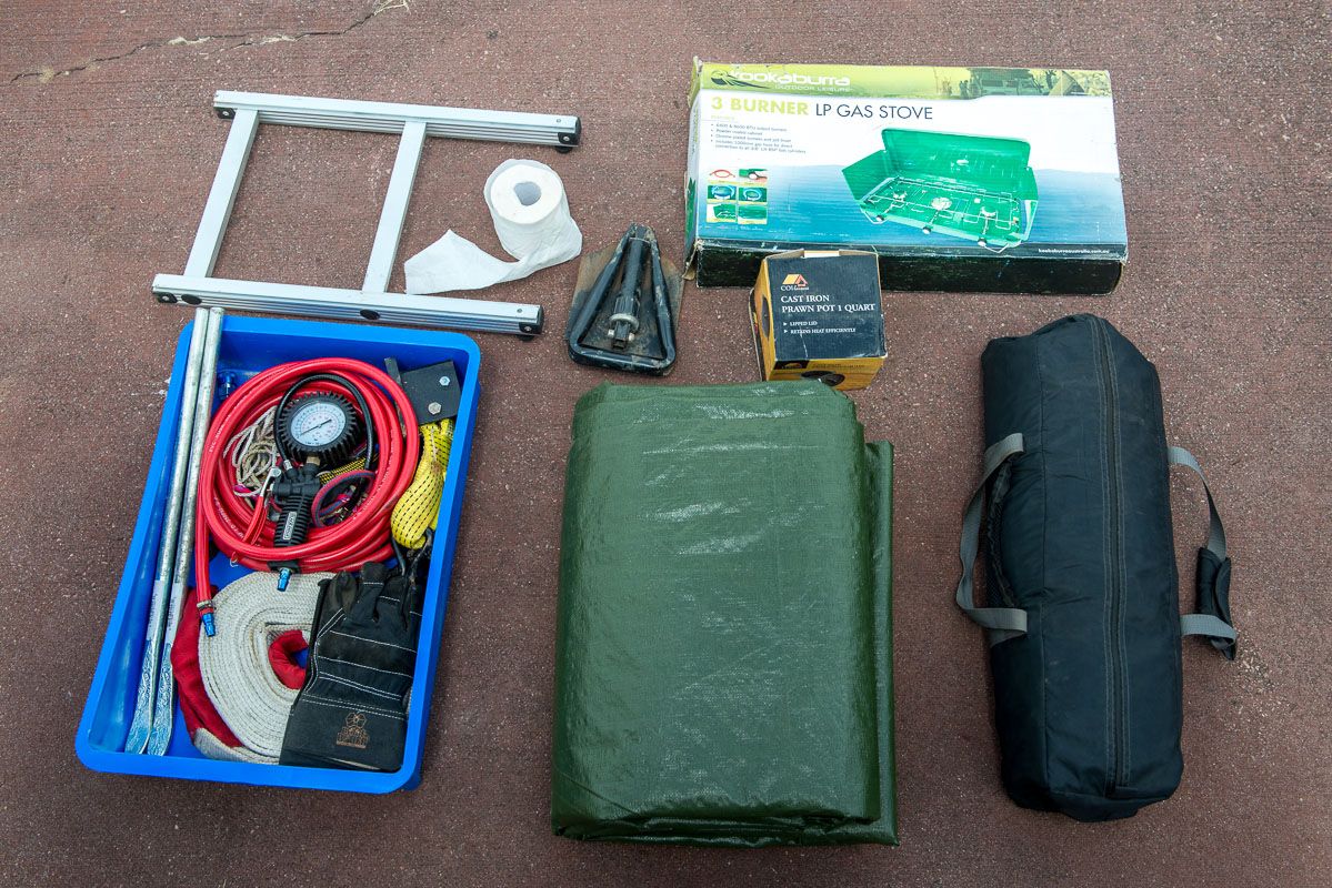 Here is what gets packed under the false floor. Lesser used items such as the 5x5m tarp and the 3 person tent towards the front of the car, the 3 burner stove and recovery gear tub sits towards the back; easily accessible.