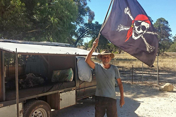 Neil waves a friendly goodbye. Can't help but wonder if the pirate flag is to ward off intruders to his secret campsites!