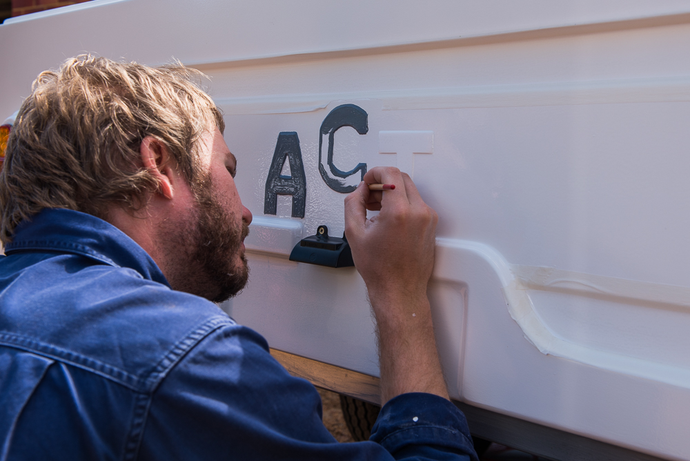 hand-painting-camper-trailer